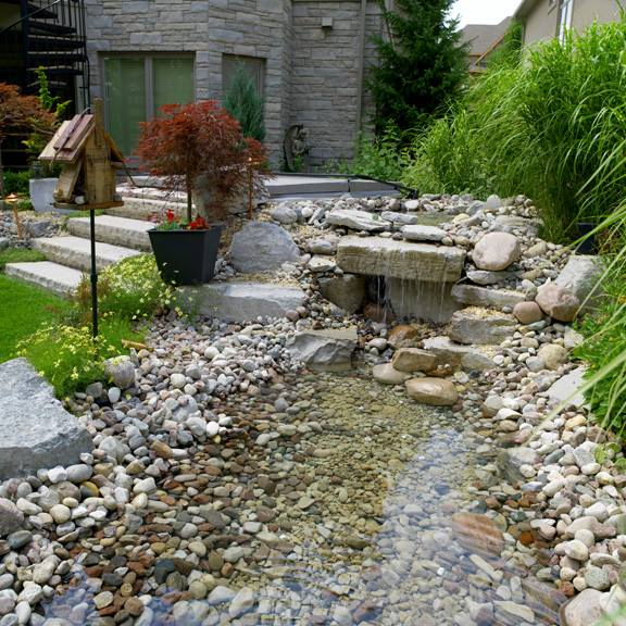pond and rock riverbed landscape construction