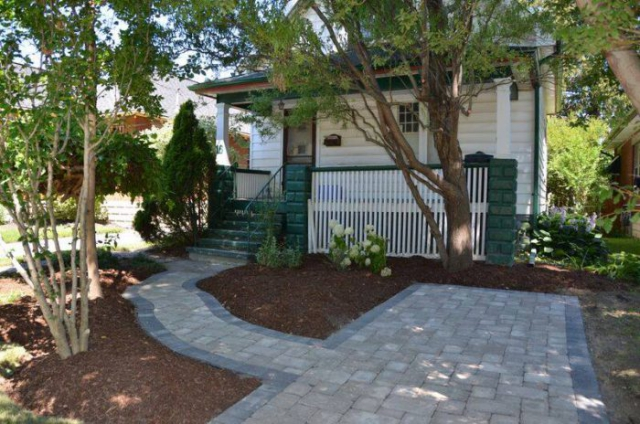 custom landscape construction - stone driveway and sidewalk by natures image